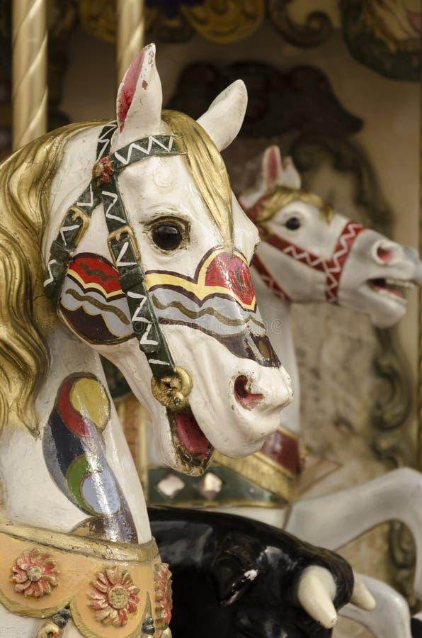 Retrato de los caballos de un tiovivo foto de archivo