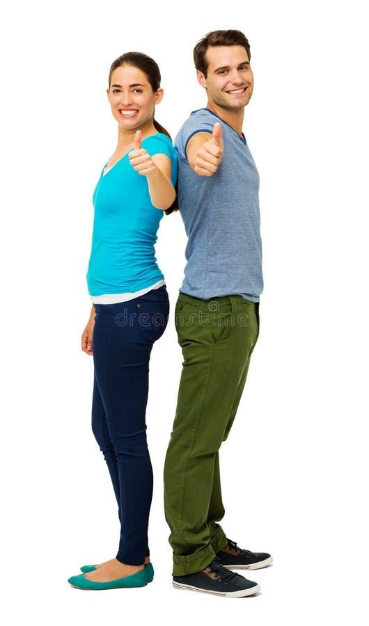 Retrato de los pares felices que gesticulan los pulgares para arriba imagenes de archivo