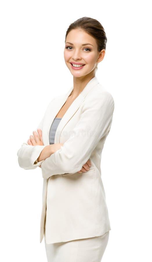 Retrato de medio cuerpo del encargado de sexo femenino con los brazos cruzados imagen de archivo libre de regalías
