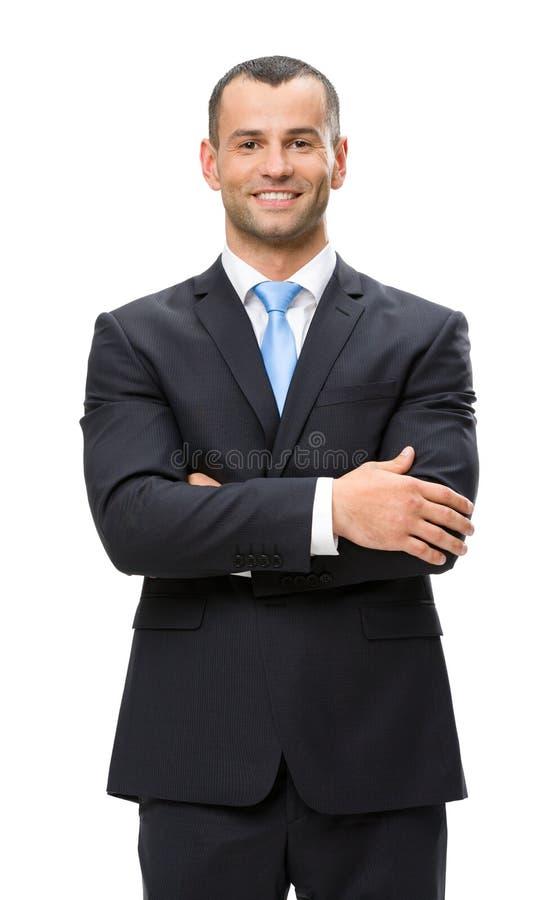 Retrato de medio cuerpo del hombre de negocios con los brazos cruzados imágenes de archivo libres de regalías