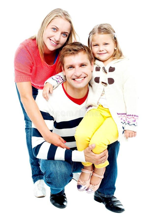 Retrato de pais felizes com sua filha fotos de stock royalty free