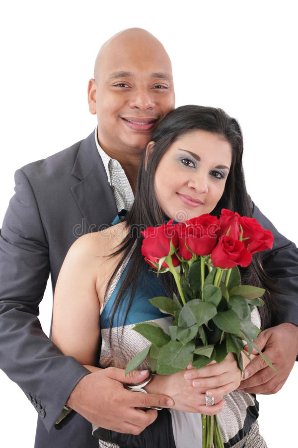 Retrato de pares felizes com flores, olhando a câmera. fotografia de stock