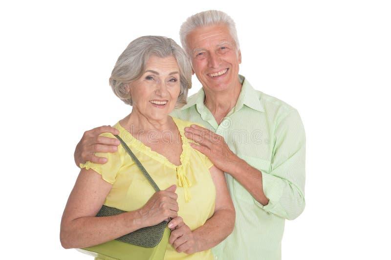 Retrato de pares mayores felices en el fondo blanco fotografía de archivo libre de regalías