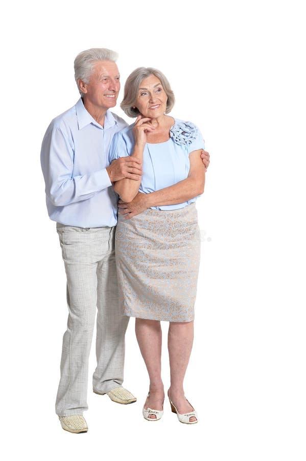 Retrato de pares superiores felizes no fundo branco fotografia de stock