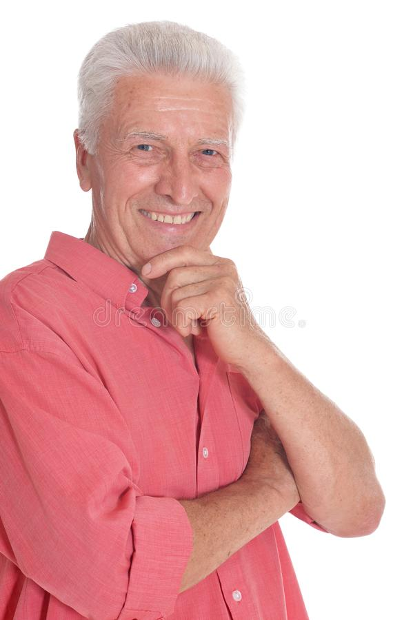 Retrato de pensar al hombre mayor en el fondo blanco imagen de archivo