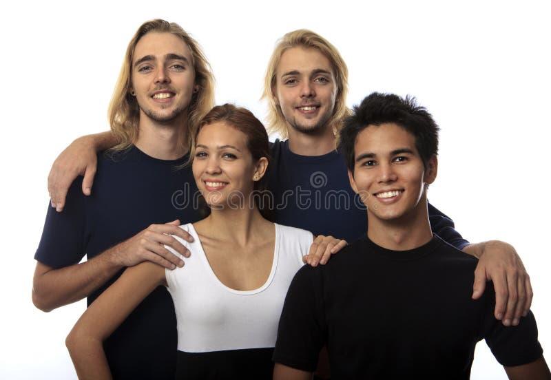 Retrato de quatro amigos novos imagem de stock royalty free