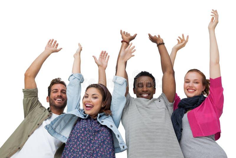 Retrato de quatro amigos novos que levantam as mãos imagem de stock