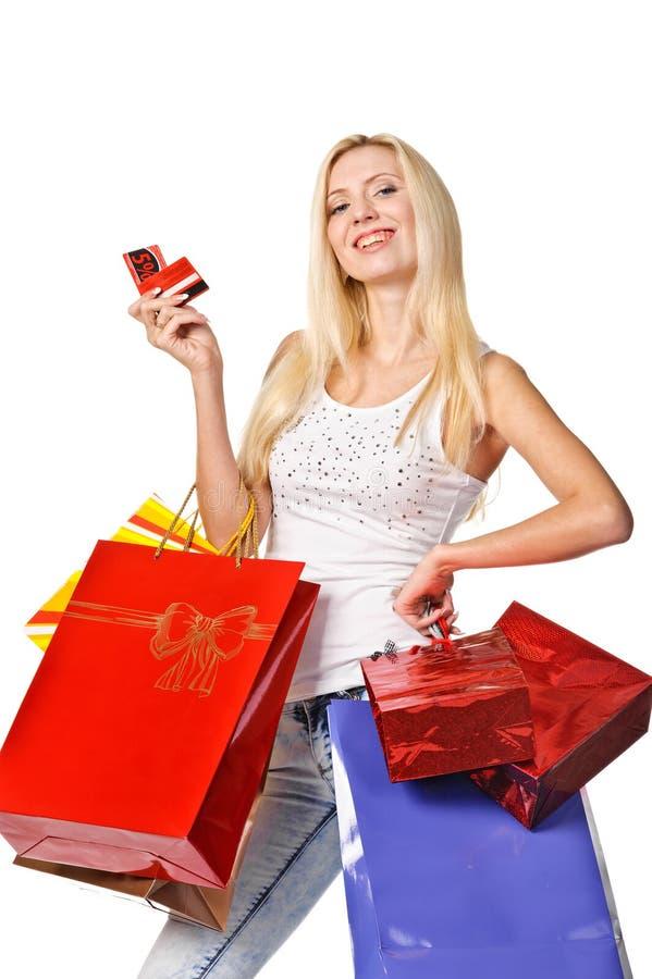 Retrato de sacos de compras levando da jovem mulher fotografia de stock