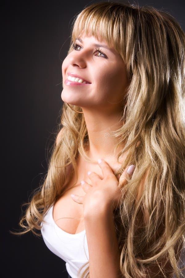 Retrato de sorriso novo do perfil da mulher foto de stock