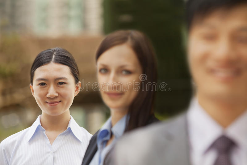 Retrato de três executivos, grupo multi-étnico imagens de stock