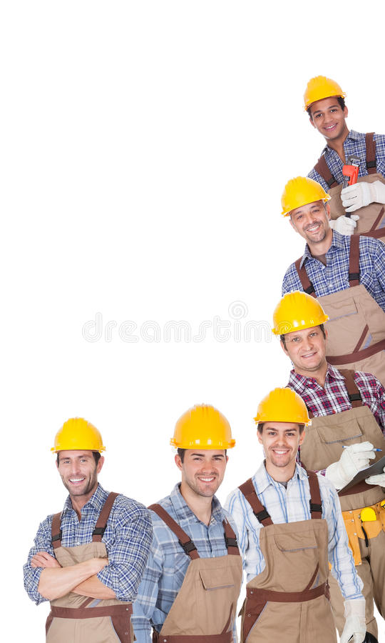 Retrato de trabalhadores industriais felizes foto de stock