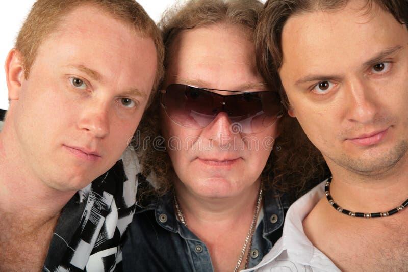 Retrato de tres hombres imagenes de archivo