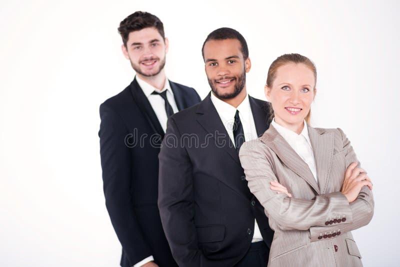 Retrato de tres hombres de negocios Tres acertados y busi sonriente foto de archivo libre de regalías