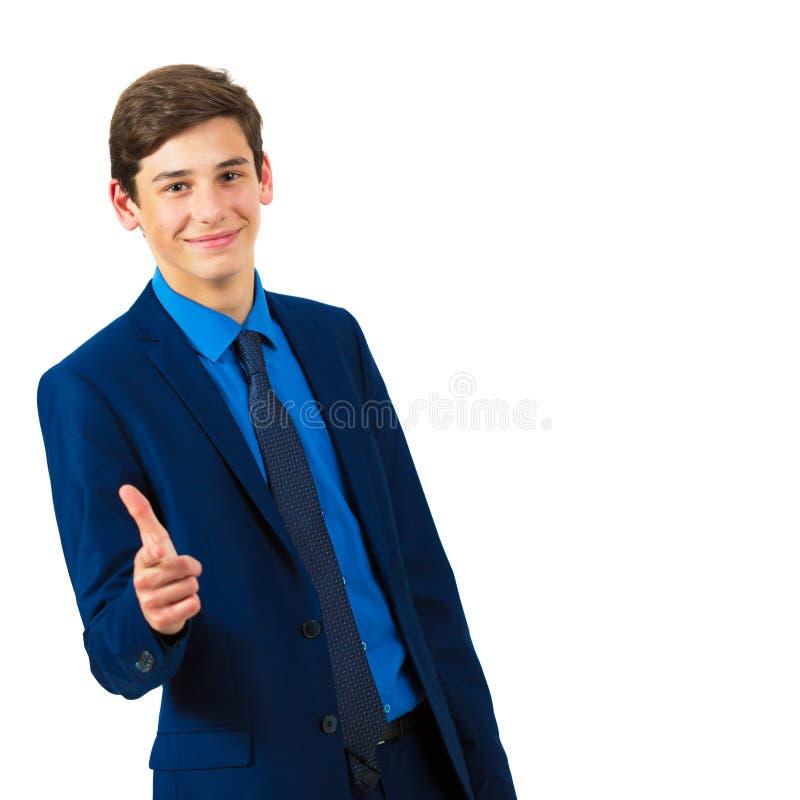 Retrato de um adolescente alegre considerável em um terno foto de stock royalty free