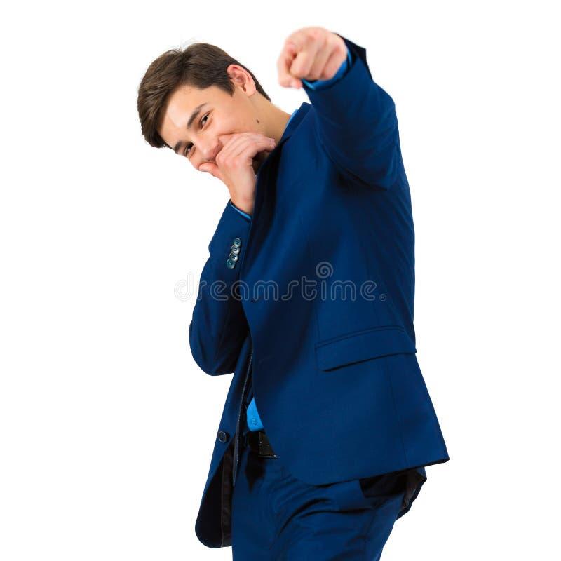 Retrato de um adolescente alegre considerável em um terno imagem de stock