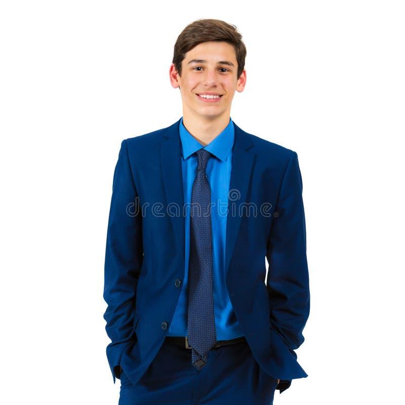 Retrato de um adolescente alegre considerável em um terno foto de stock