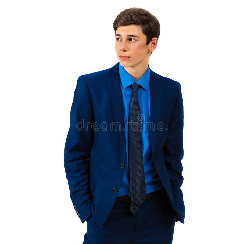 Retrato de um adolescente sério considerável em um terno fotografia de stock