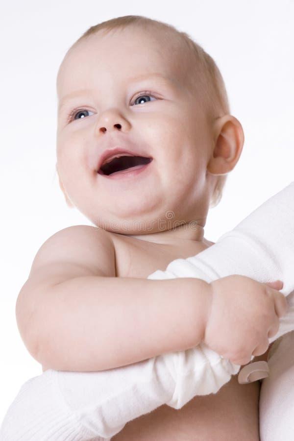 Retrato de um bebê nos braços da matriz imagem de stock