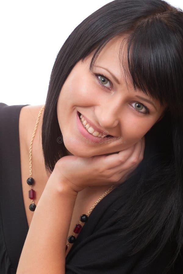Retrato de um brunette de sorriso novo imagem de stock royalty free