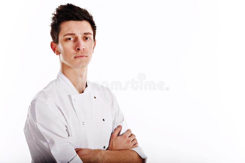 Retrato de um cozinheiro chefe novo foto de stock