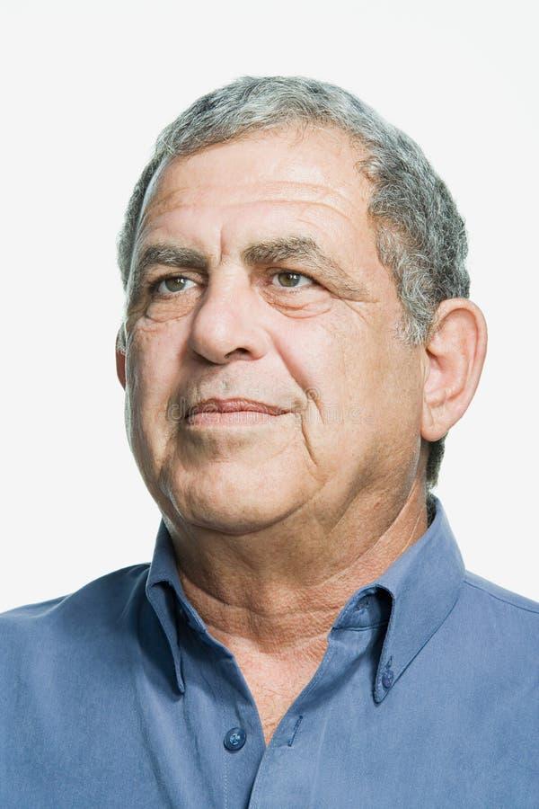 Retrato de um homem adulto superior fotografia de stock