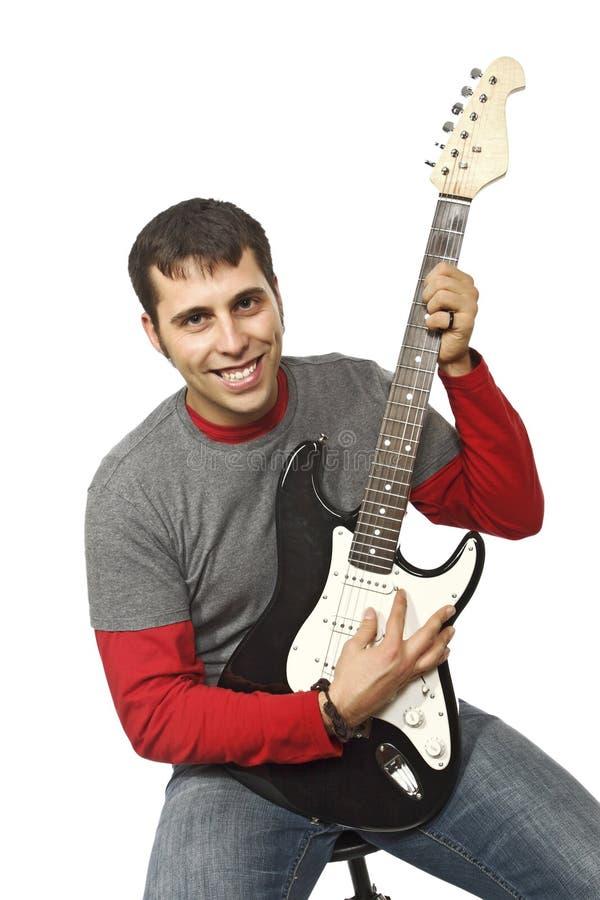 Retrato de um homem com guitarra imagens de stock