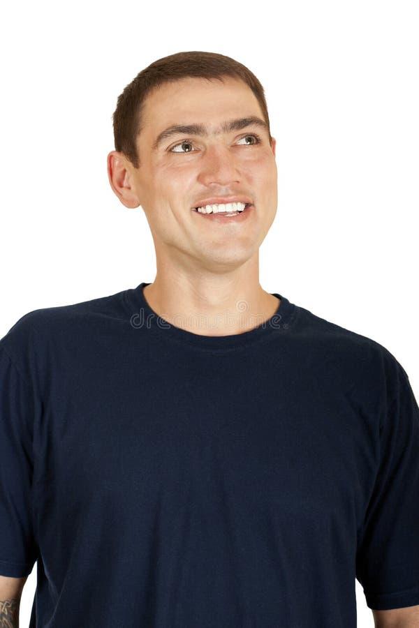 Retrato de um homem considerável novo que olha acima fotografia de stock