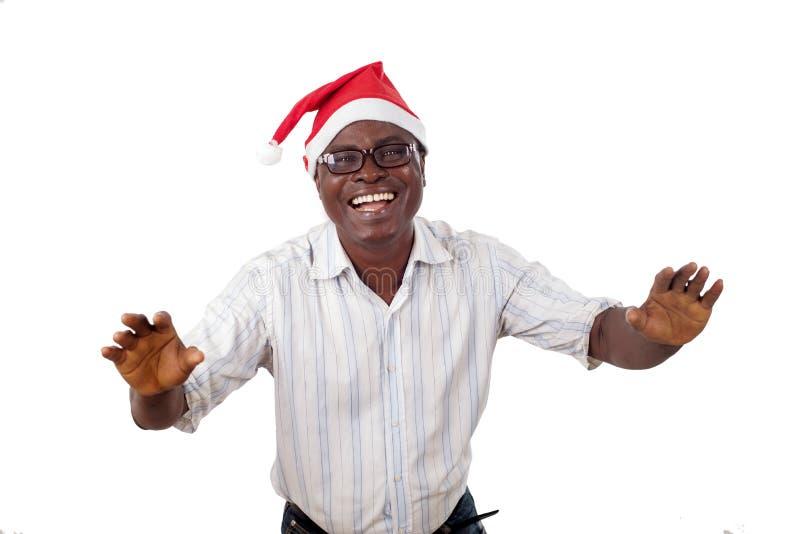 Retrato de um homem feliz que veste um chapéu de Santa Claus fotografia de stock