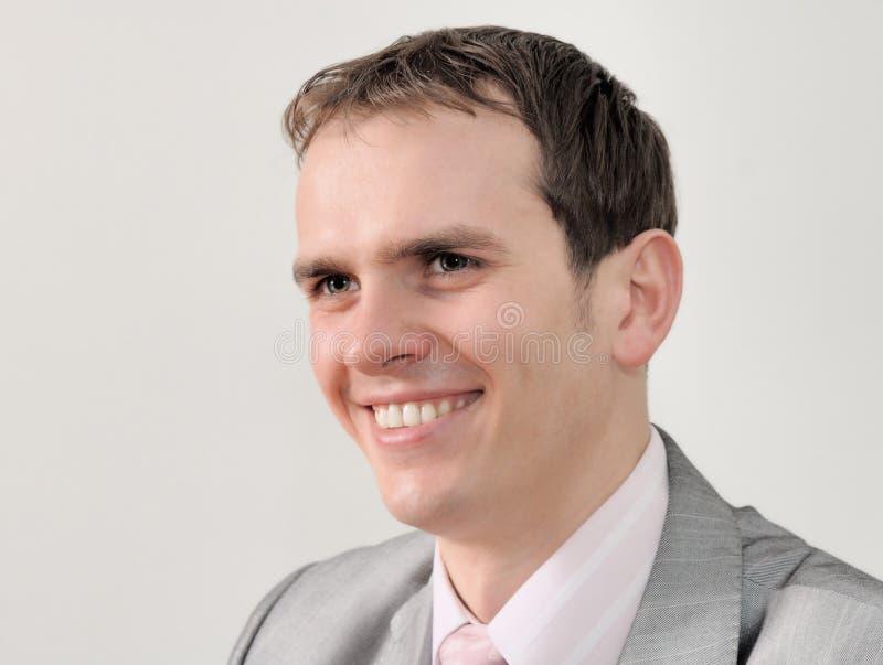 Retrato de um homem de negócios agradável isolado no fundo branco foto de stock royalty free