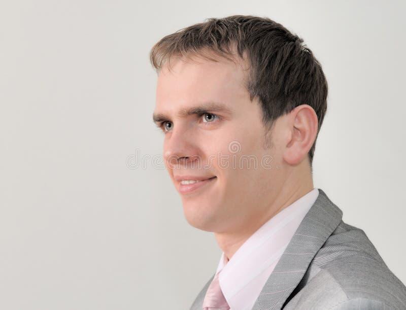 Retrato de um homem de negócios agradável isolado no fundo branco foto de stock