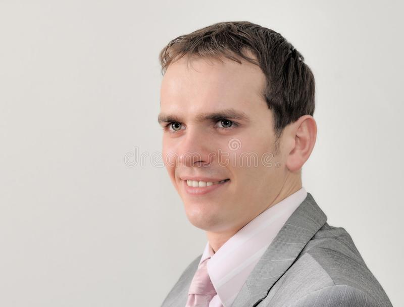 Retrato de um homem de negócios agradável no fundo branco fotografia de stock royalty free