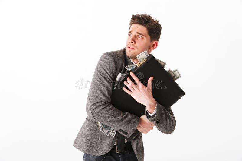 Retrato de um homem de negócios novo assustado imagem de stock royalty free