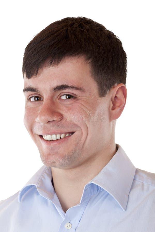 Retrato de um homem novo considerável que sorri na câmera imagem de stock