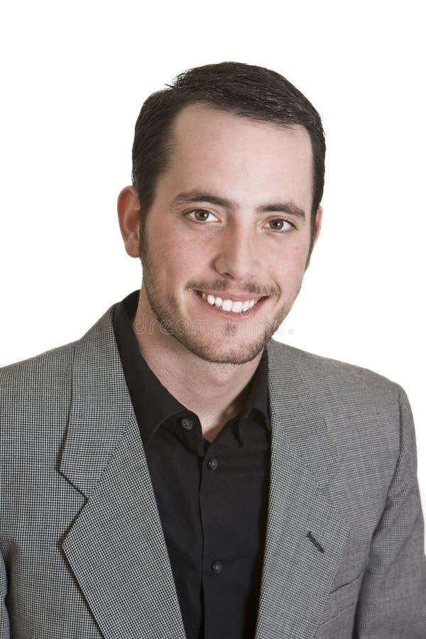 Retrato de um homem novo isolado no branco imagem de stock royalty free