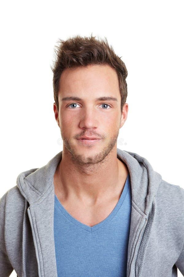 Retrato de um homem novo sportive fotografia de stock