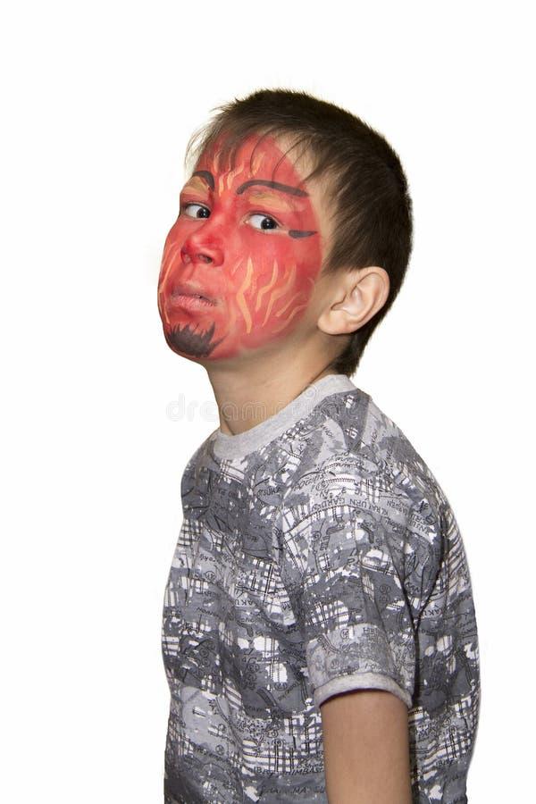 Retrato de um menino com cara pintada fotografia de stock royalty free