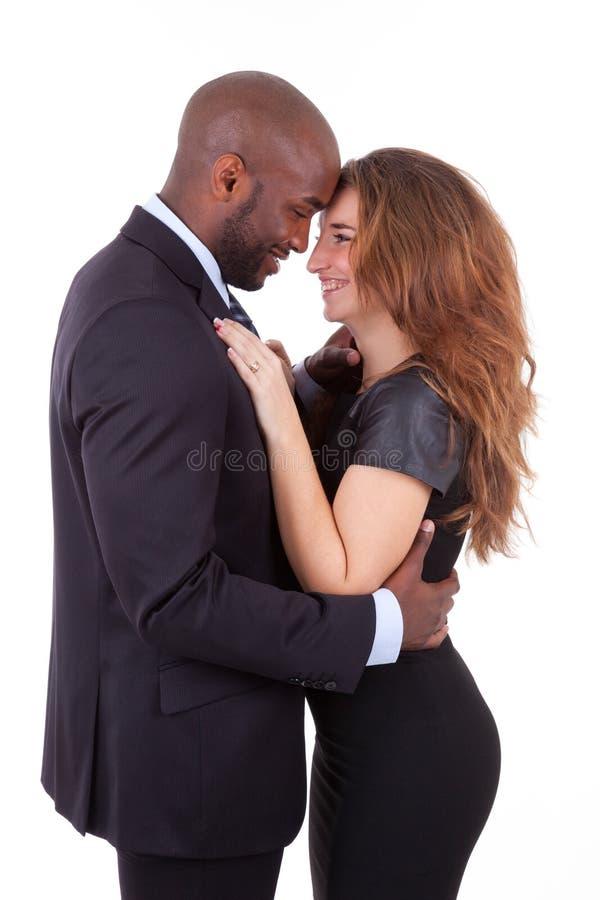Retrato de um par misturado feliz novo fotos de stock royalty free