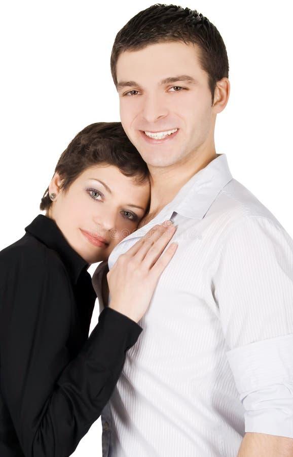 Retrato de um par novo de sorriso no amor imagens de stock royalty free