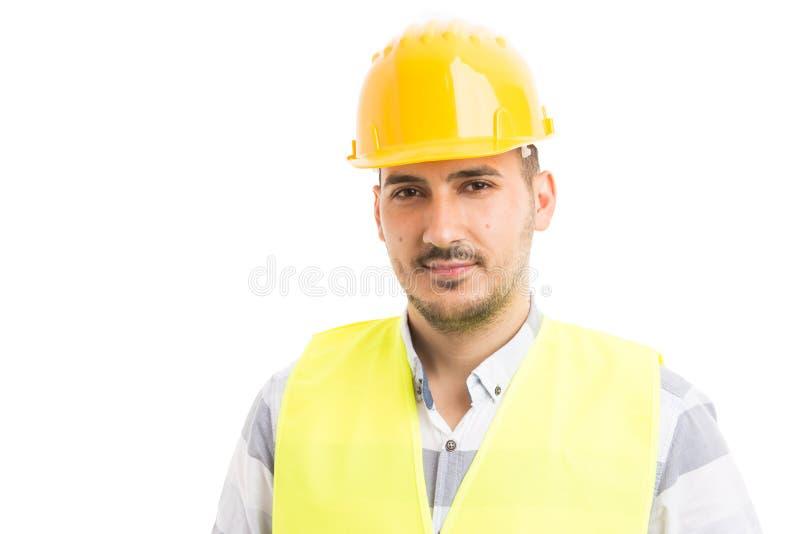 Retrato de um reparador novo ou de um construtor considerável e seguro fotografia de stock royalty free