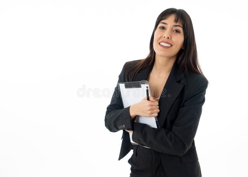 Retrato de um sorriso bonito e seguro novo da mulher de negócio Isolado no fundo branco imagem de stock