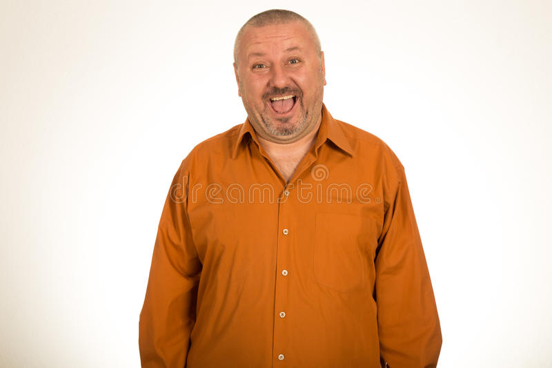 Retrato de um sorriso gordo do homem fotografia de stock royalty free