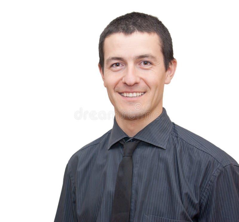 Retrato de um sorriso novo do homem de negócios imagens de stock