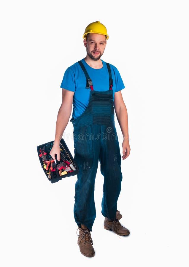 Retrato de uma caixa de ferramentas da terra arrendada do trabalhador novo fotos de stock royalty free