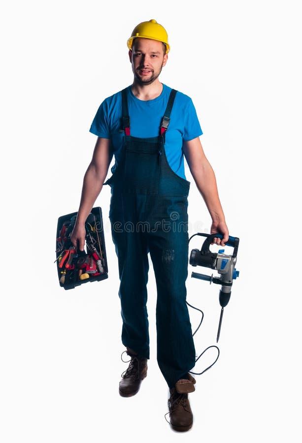 Retrato de uma caixa de ferramentas e de uma broca da terra arrendada do trabalhador novo fotos de stock royalty free