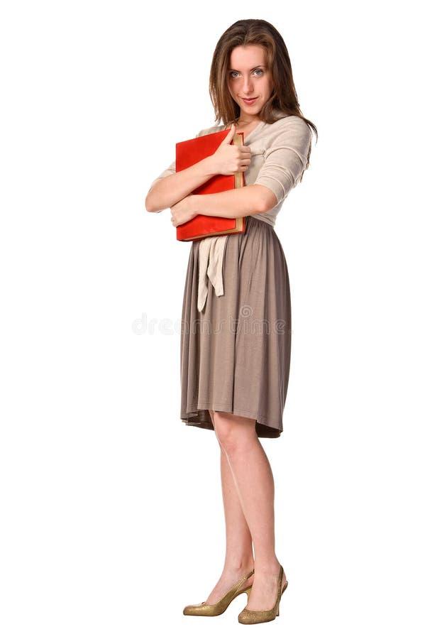 Retrato de uma estudante com livro fotos de stock