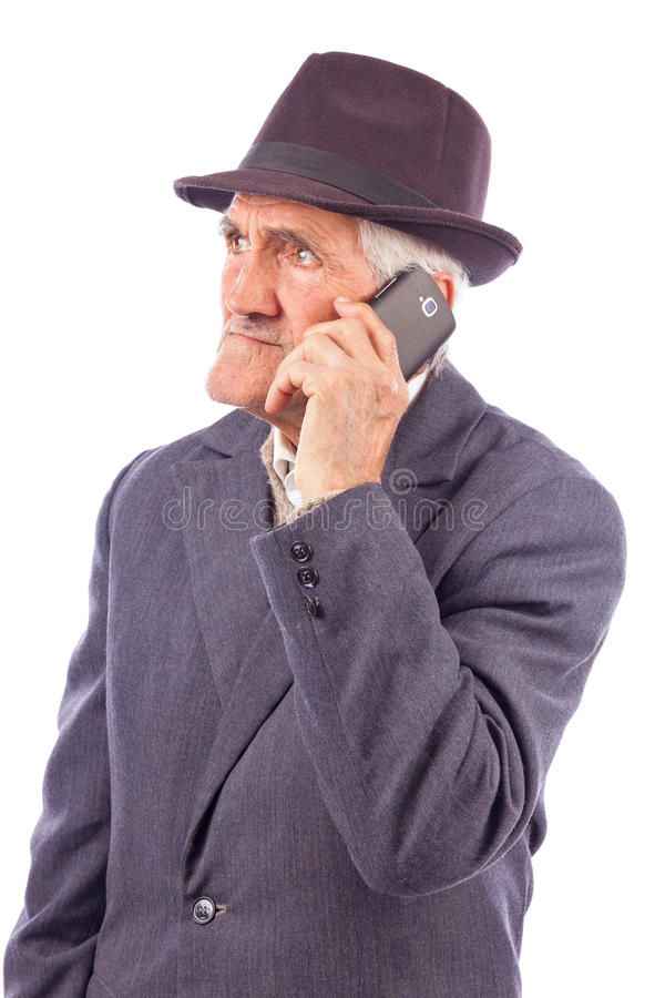 Retrato de uma fala superior expressivo no telefone imagens de stock royalty free