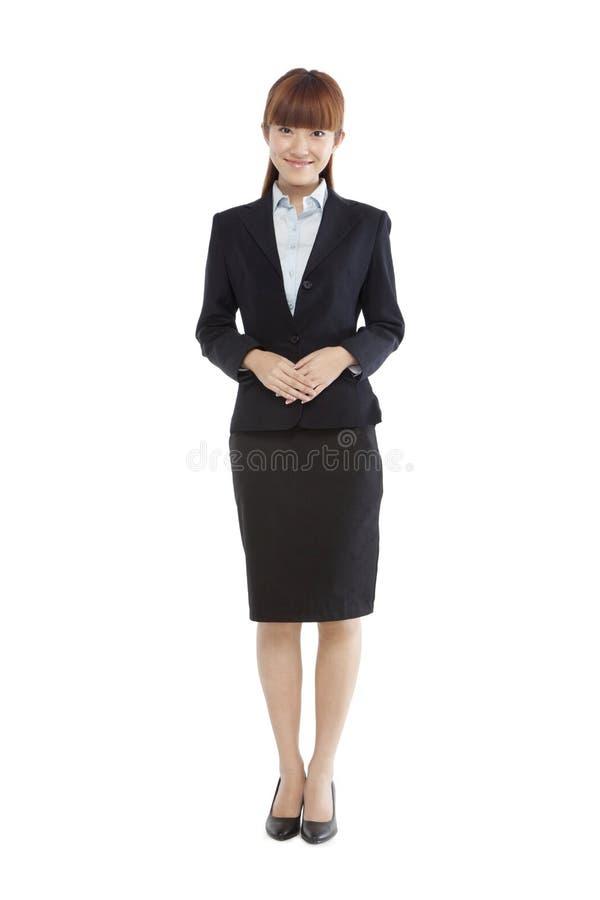 Retrato de uma jovem mulher em um terno de negócio fotos de stock