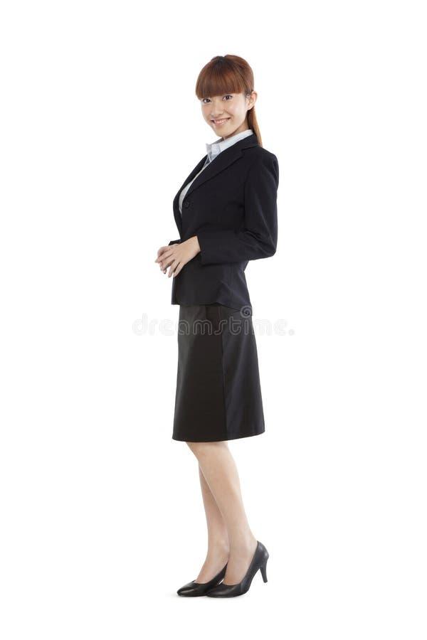 Retrato de uma jovem mulher em um terno de negócio fotografia de stock royalty free