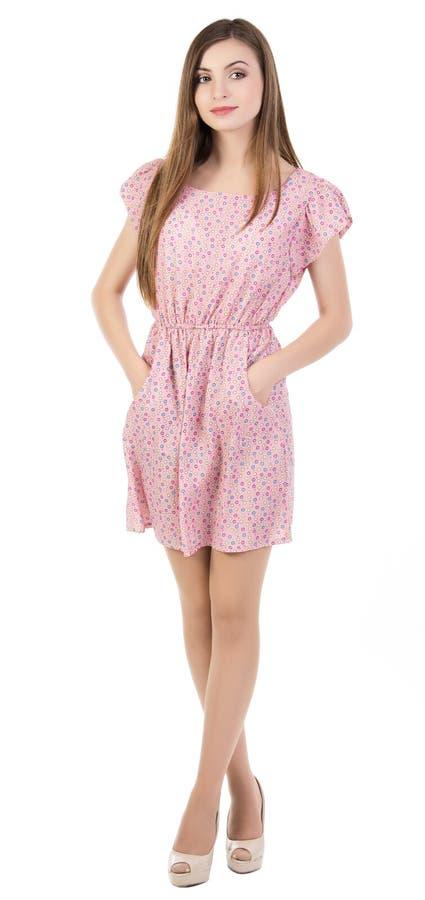 Retrato de uma jovem mulher feliz que está no branco imagem de stock royalty free