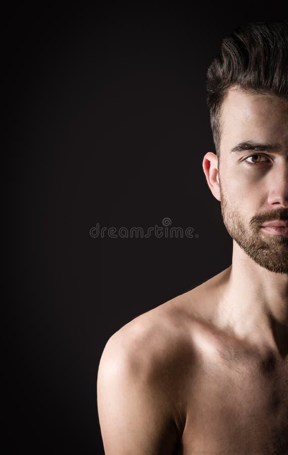 Retrato de uma meia cara do homem novo imagem de stock royalty free